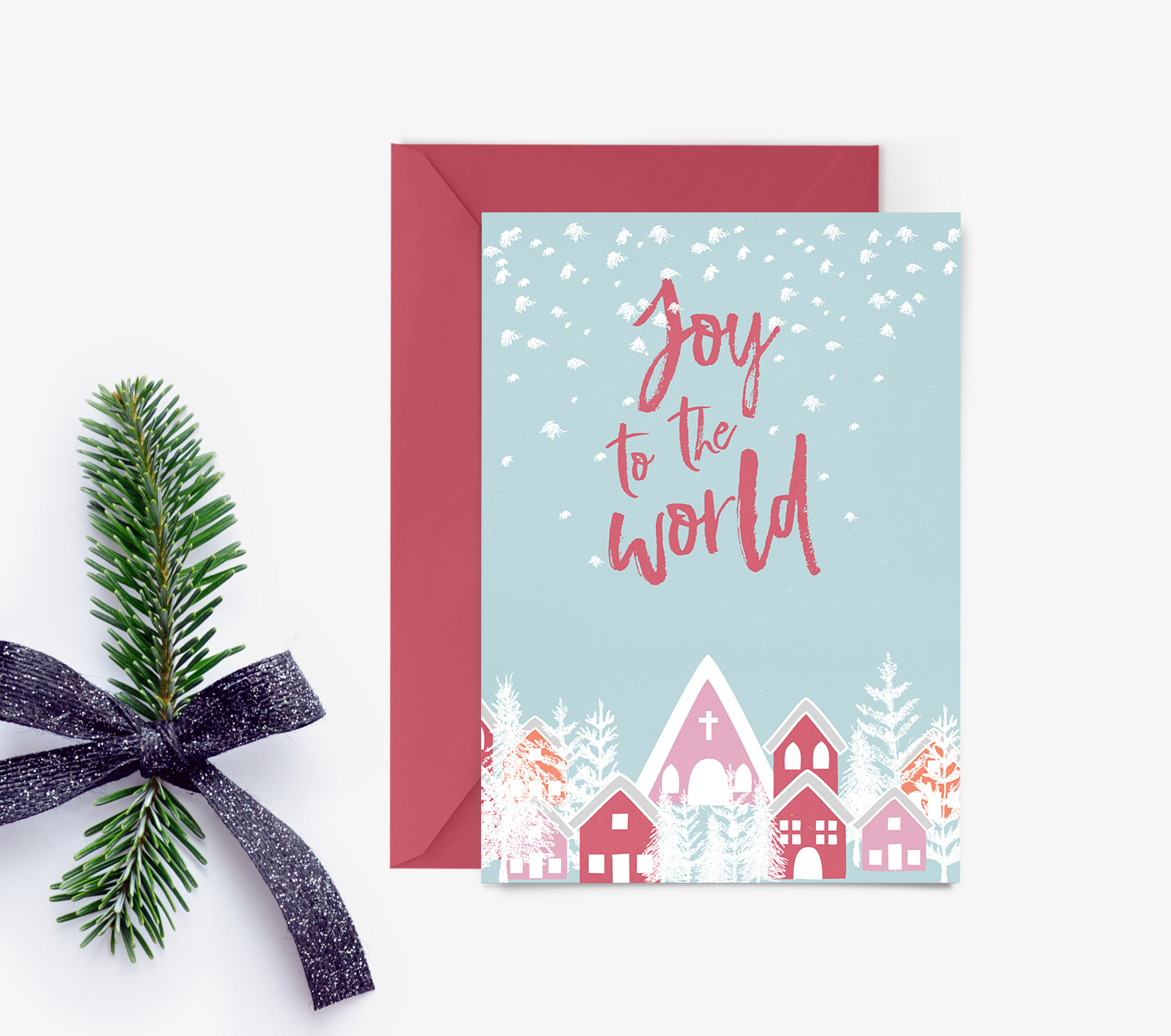 Delight friends and family with this beautiful Christmas card featuring a snowy village. Print it out as many times as you like.
